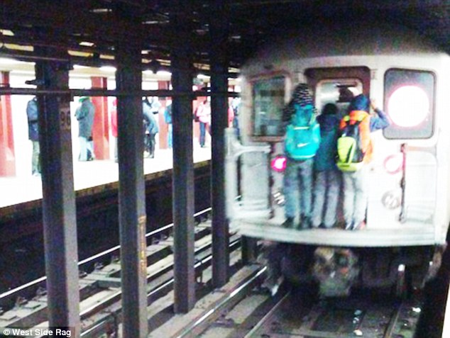 Skull image on subway train, woman dies